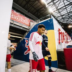 Manolo Sanchez - drafted by RBNY and given time with NYRB II to prove himself - flanks Lewis as the teams walk out at RBA