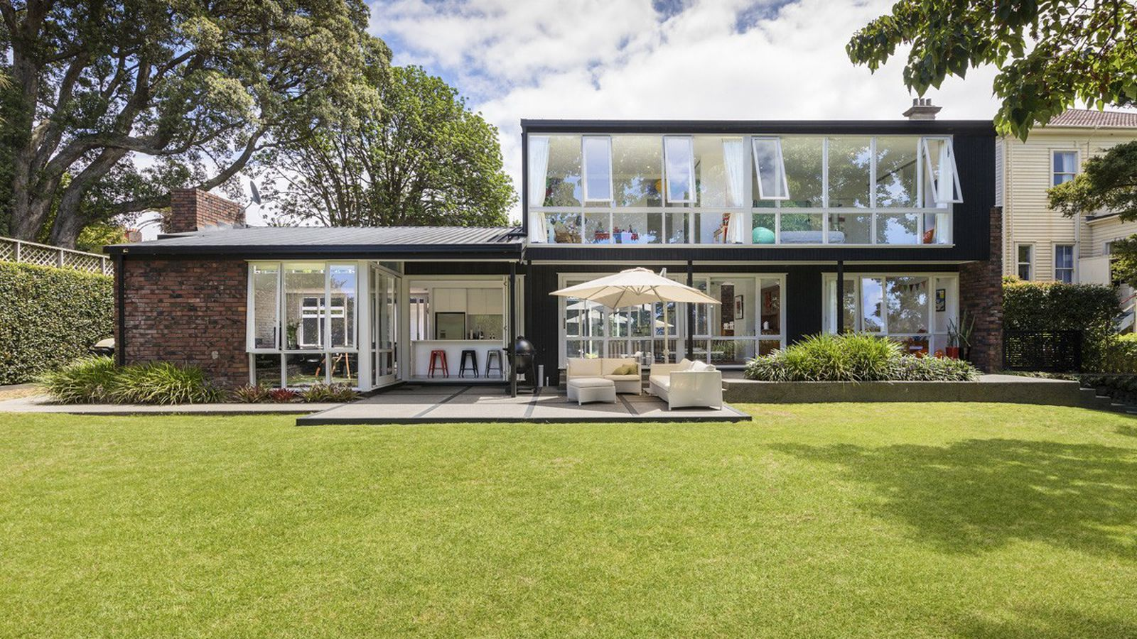 Nab this lovingly renovated midcentury home in new zealand for Modern new zealand homes