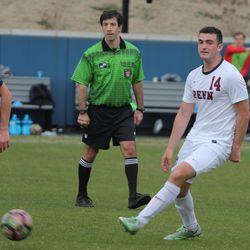 Gideon Metrikin plays the ball forward