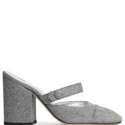 "<a href=""https://www.alexachung.com/row/mid-heel-mules-silver-75"">Mid-Heel Mules</a>, $475"