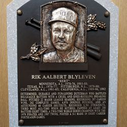 Just below this plaque, there's a pile of ever-burning baseball cleats.
