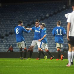 Jack Thomson is congratulated by his teammates after scoring a phenomenal long-range strike