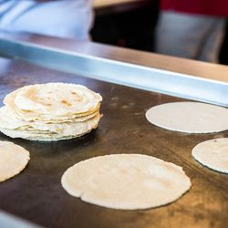 Corn tortillas on the grill at Taco Ssam.<br>