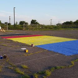 Laying out the tifo and painting the colors of the rainbow
