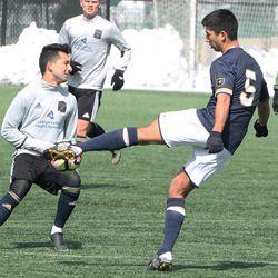 Felicien Dumas tries to clear the ball