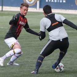 Ilsinho makes a move with Amar Sejdic defending
