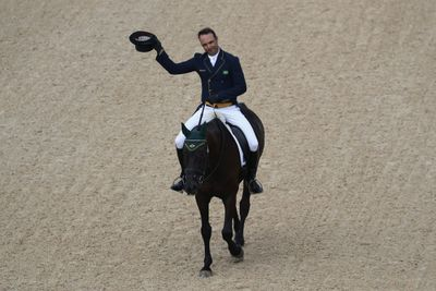 Ruy Fonseca of Brazil riding Tom Bombadill Too tips his top hat to the crowd.