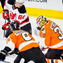 Neuvirth taking a puck to the face mask