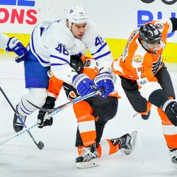 Roman Polak being checked and lifted off the ice during the first period
