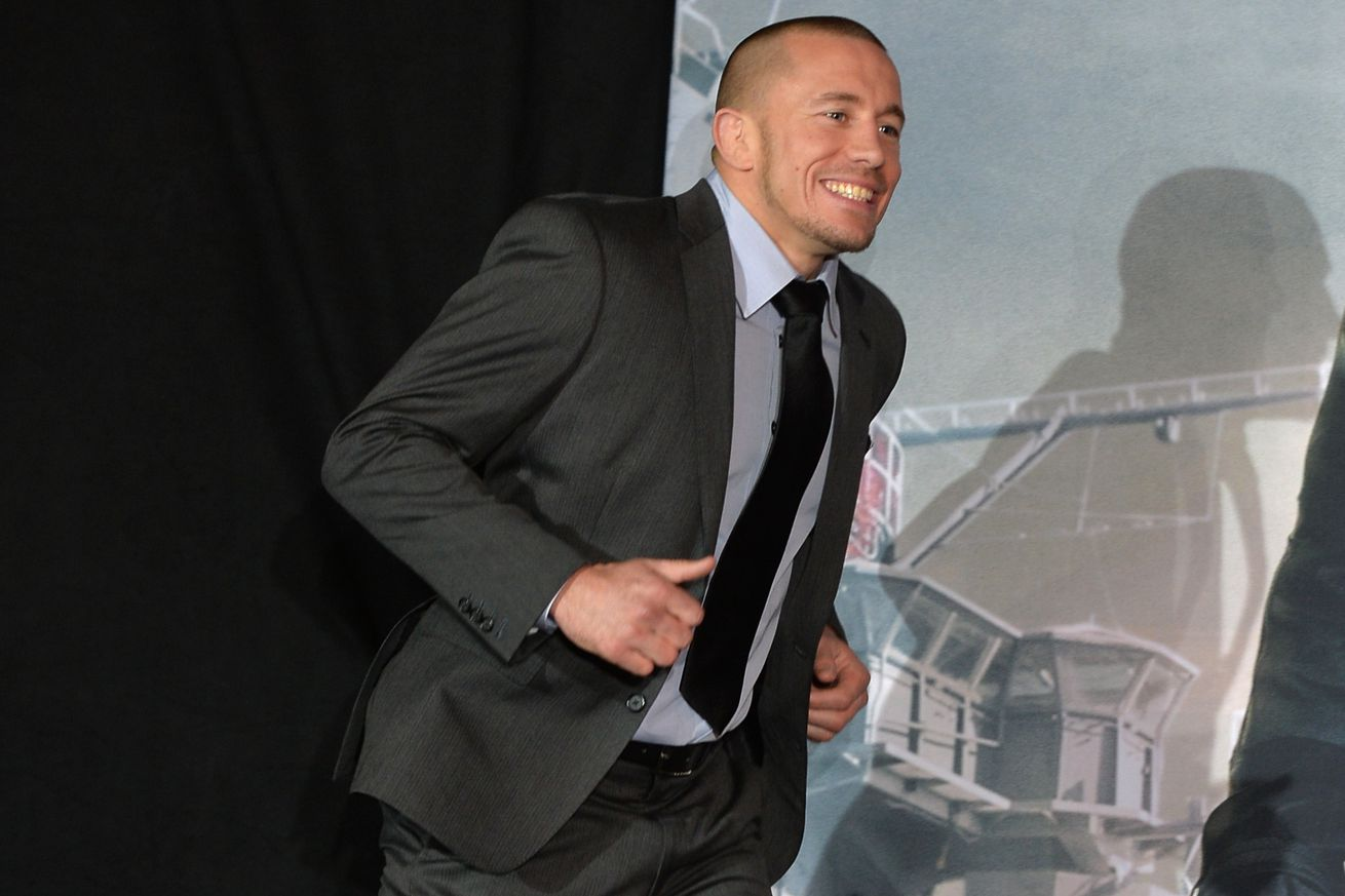 Georges St Pierre fans are running to the betting window after bookies drop Tyron Woodley odds