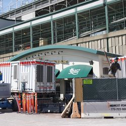 Construction equipment around the Draft Kings club and the Billy Williams statue, at Addison and Sheffield
