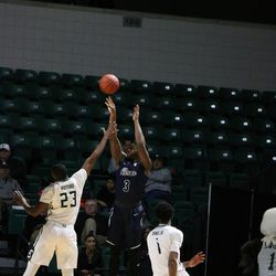 Akron launches one of many three pointers.<br>