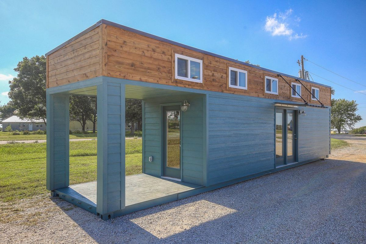 Slick tiny house converted from 40 foot shipping container curbed - Shipping container homes chicago ...