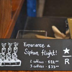 Sign advertising siphon coffee service at the Starbucks Reserve Bar in Brookland.