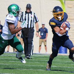 A Toledo running back trying to shake off Vince Calhoun<br>