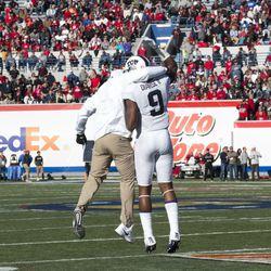 Curtis Luper congratulates John Diarse on his second Liberty Bowl touchdown.