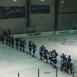 The Dallas Police Department hockey team lines up for the national anthem at the inaugural Dallas Strong Hockey charity game.