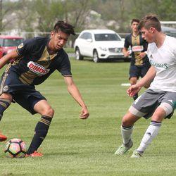 Kalil ElMedkhar on the ball with Zachary Lysakowski defending