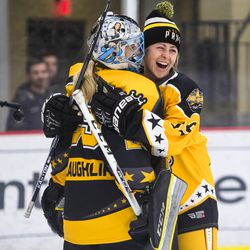 Boston Pride Defenseman Gigi Marvin laughs with Beauts Goaltender Brianne McLaughlin after beating her with a sneaky wrist shot during the shootout challenge at the NWHL All-Star game in Pittsburgh.