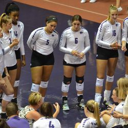 MANHATTAN - K-State volleyball coach Suzie Fritz, crounching bottom left, talks to her team during a timeout in a match against Arkansas on Aug. 31, 2017.