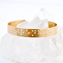 """Leigh Luna <a href=""""https://www.etsy.com/listing/118052945/custom-braille-bracelet-custom-engraved"""">Custom Braille Bracelet</a>, $79"""
