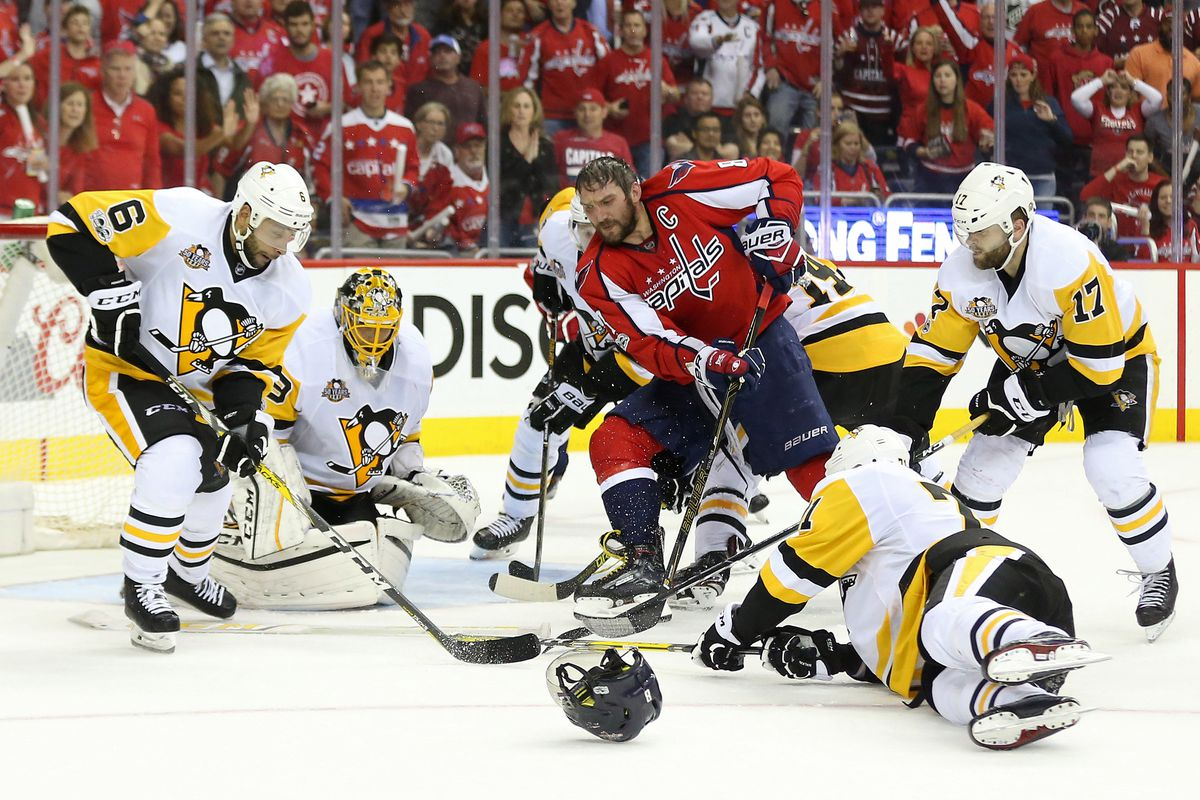 Capitals win in OT; Penguins lose Crosby to injury