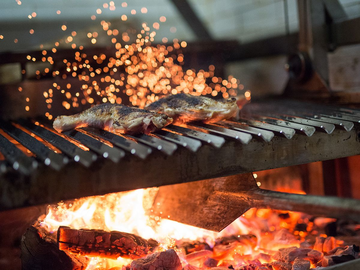 14 wood fired restaurants to ward off winter eater ny for Fish on fire menu