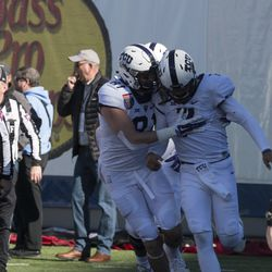 Cole Hunt congratulates Kenny Hill on after touchdown run.