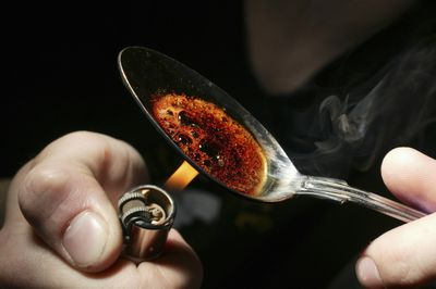 A drug user prepares heroin.