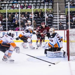 A puck goes just wide of the Gulls' crease