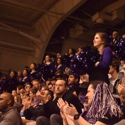 A Northwestern cheerleader is all smiles as the Selection Sunday ceremonies come to a close.