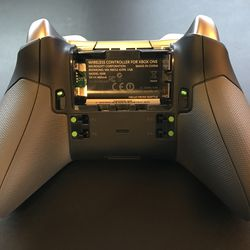 The green buttons are tapped by the pegs on the paddles