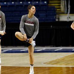 UConn's Natalie Butler (L), Kia Nurse (C) and Molly Bent (R) warms up before their Sweet 16 practice.<br>