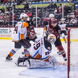 """Selleck and Gaudet jab at the Gulls' goaltender, trying for a """"dirty"""" goal"""
