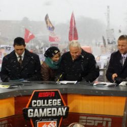 Lee Corso (getting prepped) between David Pollack and Kirk Herbstreit