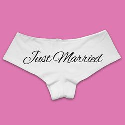 "Bridesmaid T-shirts <a href=""https://www.etsy.com/listing/223826991/just-married-underwear-panties-bride?utm_campaign=shopping_us_BridesmaidTshirts_sfc_osa&utm_medium=cpc&utm_source=google&utm_custom1=0&utm_content=8885697&gclid=CJWdmL7rpdQCFZWEswodwd8Ahg"">""Just Married"" Panties</a>, $15"