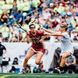 Kate Weeks runs past a Maryland player
