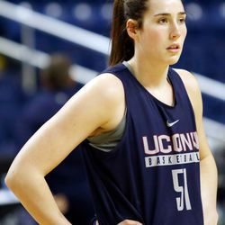 UConn's Natalie Butler listens to instructions during a drill at their Sweet 16 practice.<br>