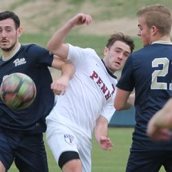 Javi Perez (left) and Joe Swenson (middle) fight for the ball