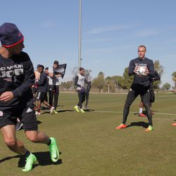 Diego Fagundez and Cody Cropper train in their Patriots tees while Chris Tierney (right), Lee Nguyen (center) and Joshua Smith (left center) get suited up.