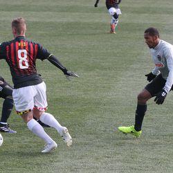 Gordon Wild dribbles the ball with Giliano Wijnaldum and Auston Trusty defending