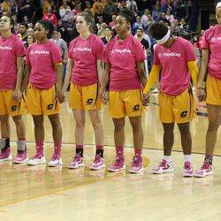 The Central Michigan team hold hands during the Star Spangled Banner.