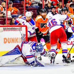 Players scramble in front of Lundqvist.