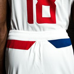 """Back view of the Clippers' white """"Association edition"""" jersey.  The red stripe on the left (port) side represents a traditional nautical light on the port side of a ship."""