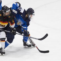 Team Germany defenseman Anna-Maria Fiegert and Team Finland forward Susanna Tapani tangle.