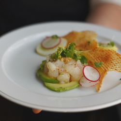 Marinated halibut with espelette pepper, avocado, and almonds