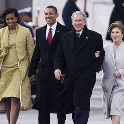 Michelle Obama (left), Barack Obama (center left), George W. Bush (center right), and Laura Bush (right)