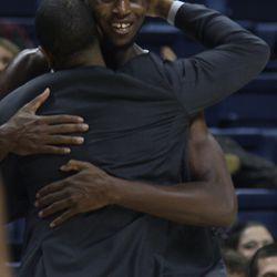 Head Coach Kevin Ollie hugs Kentan Facey