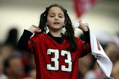 A fan of the Atlanta Falcons supports her team against the San Francisco 49ers in the NFC Championship game at the Georgia Dome on January 20, 2013.