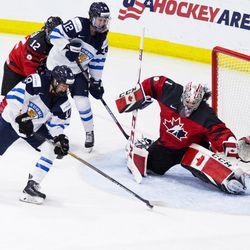 Team Canada goaltender Shannon Szabados makes a save.